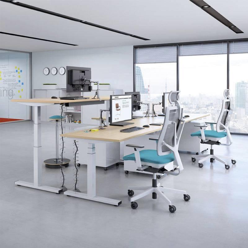 Bureau réglable en hauteur par cran, par manivelle ou par commande électrique